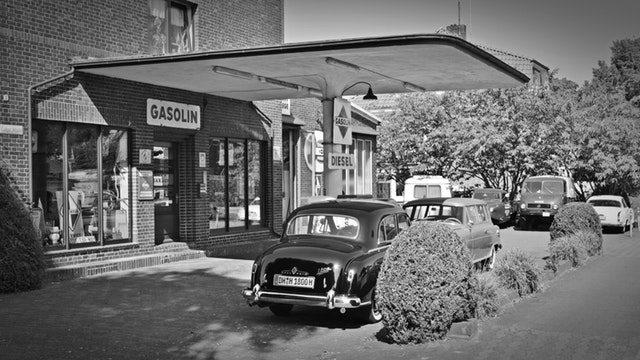 old cars at petrol station