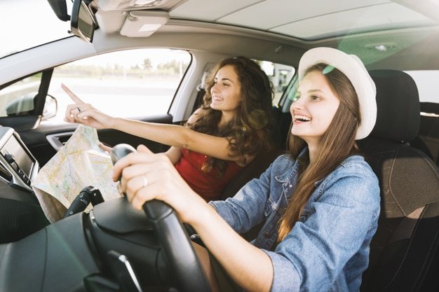 cheerful women driving car - Games For Your Next Road Trip