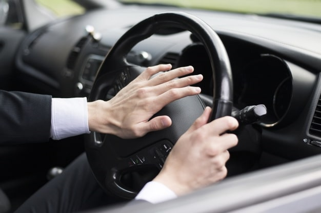 man honking - 5 Powerful Reasons to Drive Slower, and How to Do It